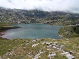 panorama of a mountain lake and fog over the Pyrenees