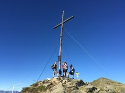 happy young people on mountain summit at Cross, austria, Fiss