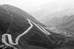 black and white photo of a zigzag mountain road in Pakistan