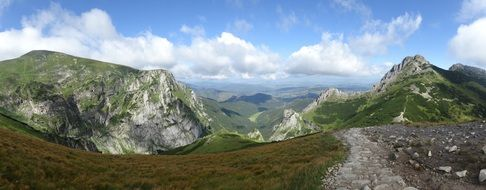 panoramic view of the Tatra mountains under white clouds