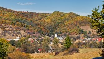 town in mountains in autumn