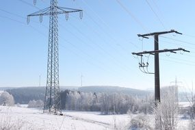 power lines amid a winter landscape