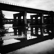 black and white photo of a steel railway bridge