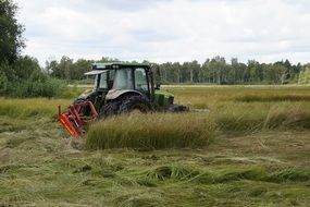 mower-tractor on green grass in a nature reserve