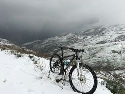 mountain bike on a snowy slope