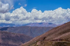 panoramic view of mountains under white clouds