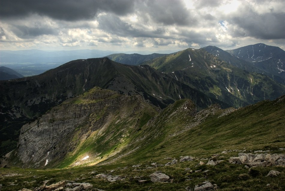 Beautiful landscape of green Tatry mountains in Poland under cloudy sky