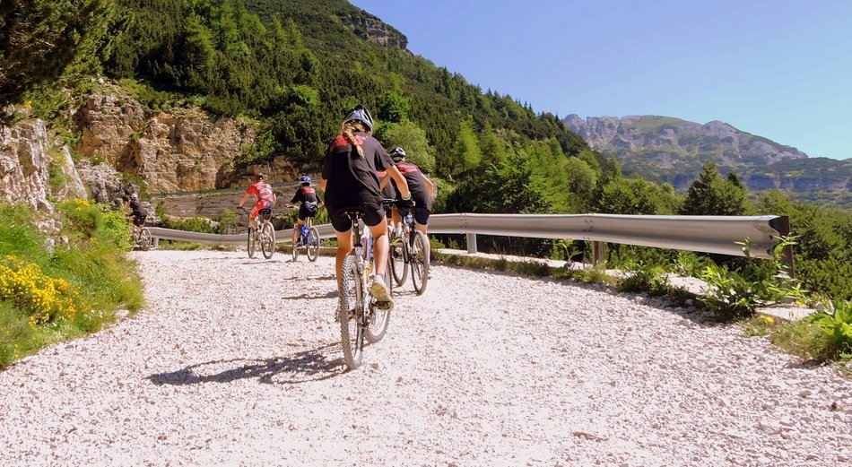 cyclists in mountains on a sunny day