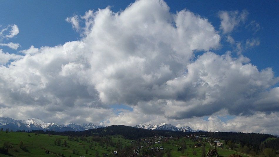 distant view of the high Tatras under white clouds