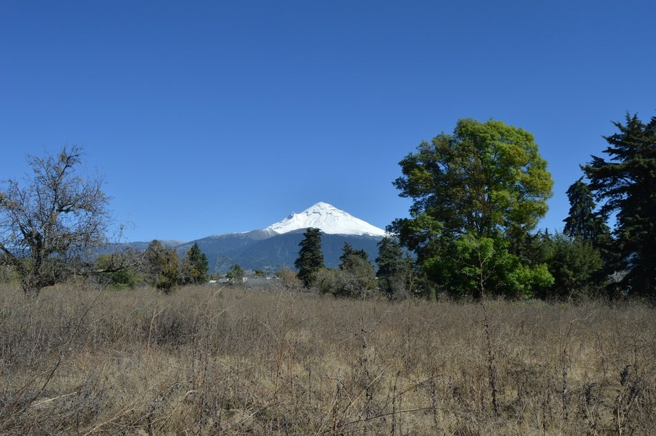 distant view of popocatepetl volcano in mexico