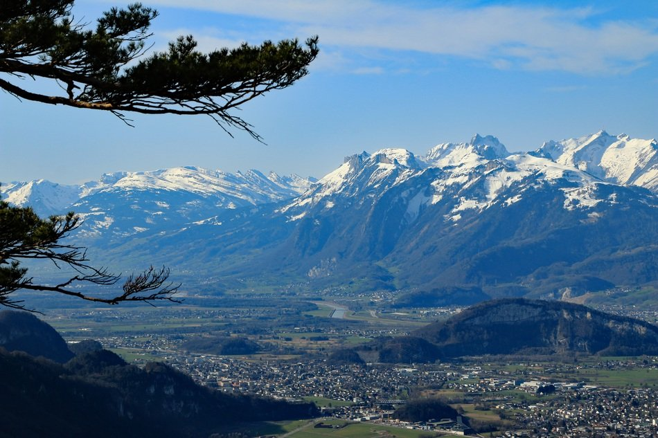 distant view of a village at the foot of Mount Sentis in the Swiss Alps
