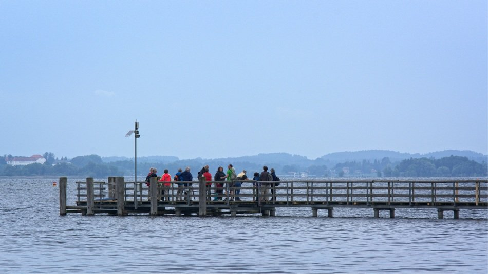 distant view of people on a wooden pier