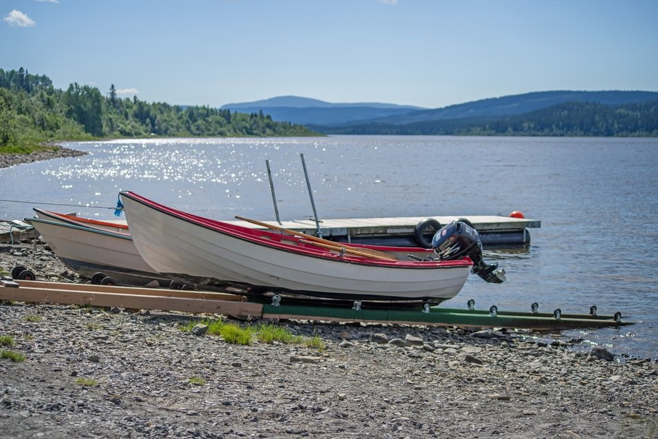 fishing boats with motors on a lake in Sweden