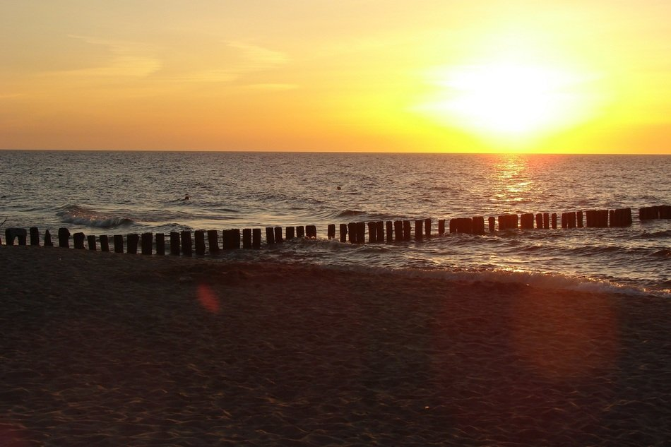 breakwater on the Baltic sea in the rays of a sunset