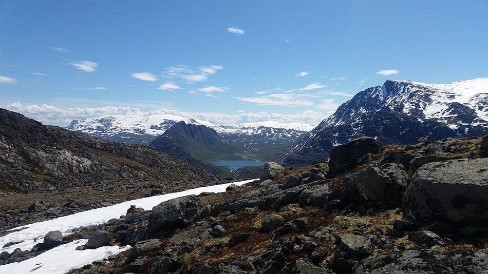 panoramic view of a mountain range in norway on a sunny day