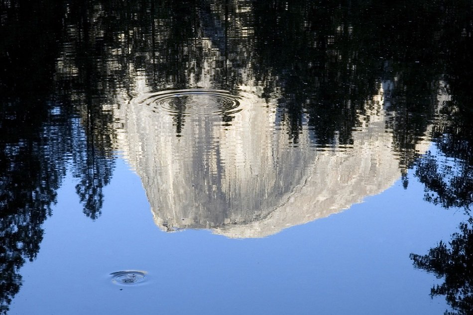 Reflection of mountain on Blue Water