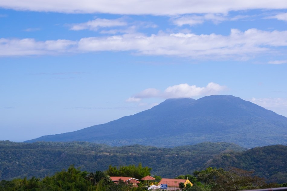 distant view of the village at the foot of the volcano