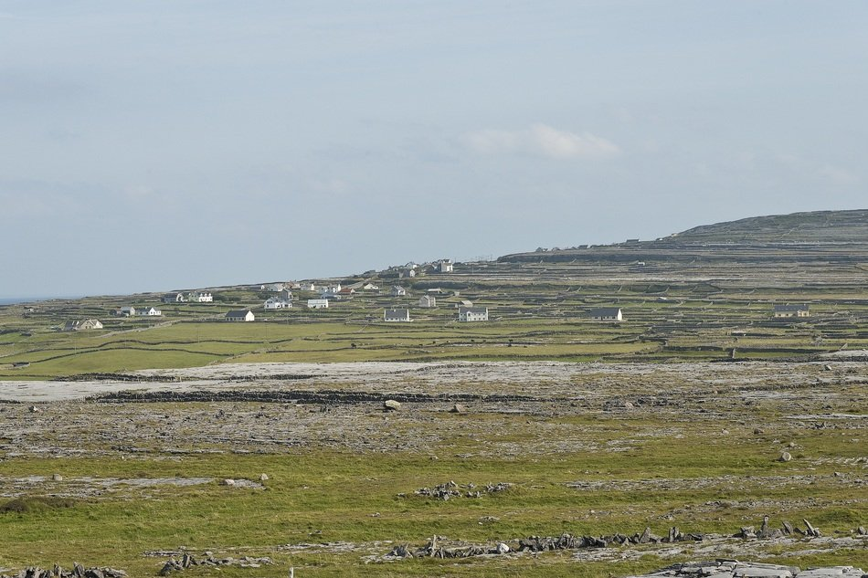 distant view of a village in the mountains of aran islands