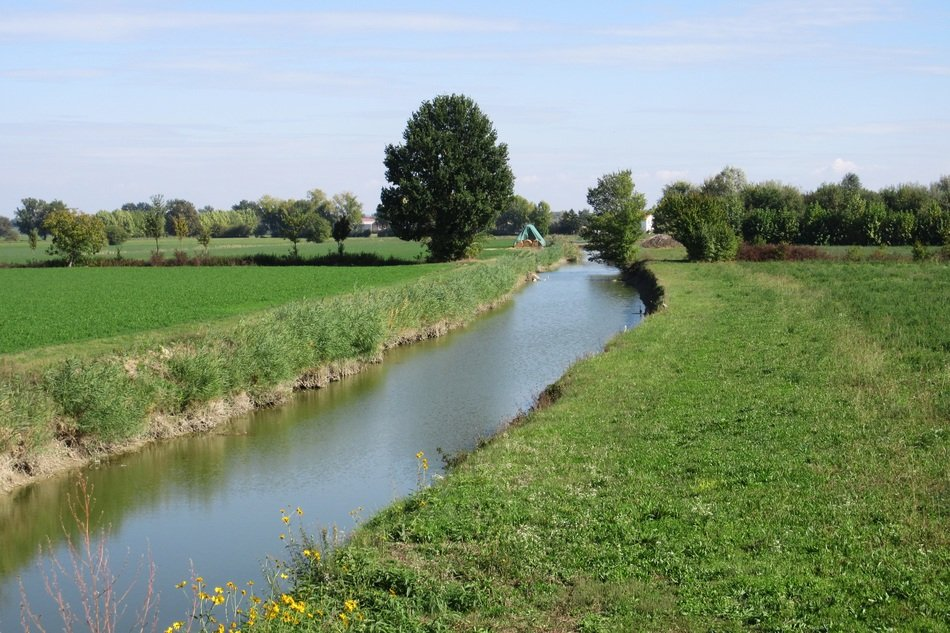 water channel among green fields in the countryside