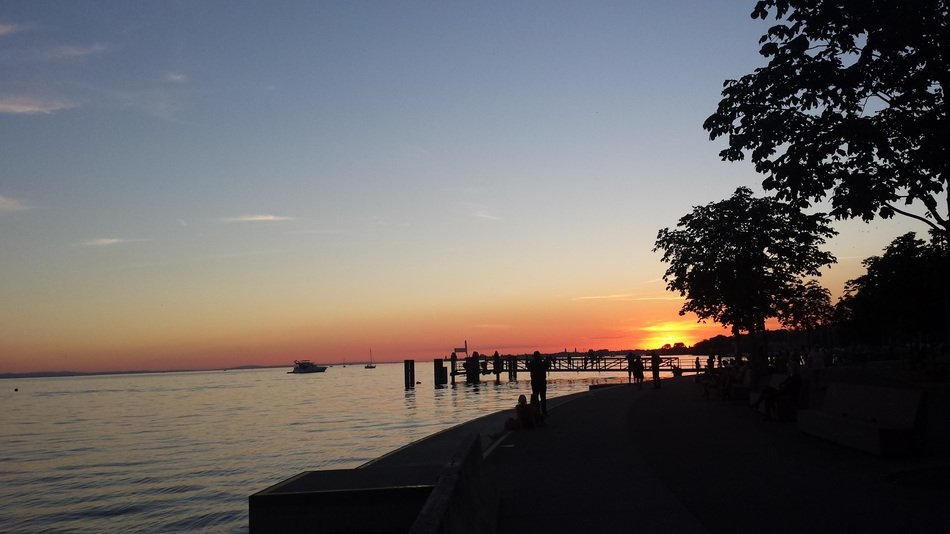 Landscape of sunset over the pier on Lake Constance
