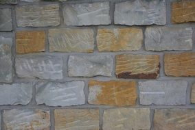 yellow-gray stone wall