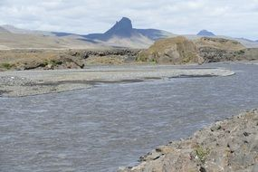 distant view from a river to glaciers in iceland
