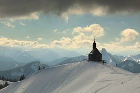 Church on top of a snowy mountain