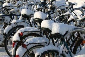 snow on the bicycles