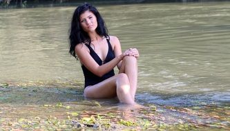 pretty brunette sitting in the water