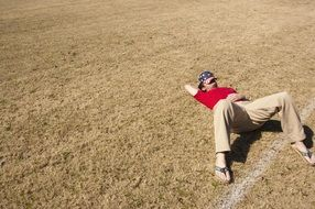 Picture of Sleeping Man on a field
