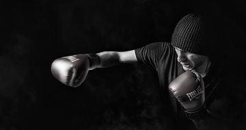 boxer in training in black and white image