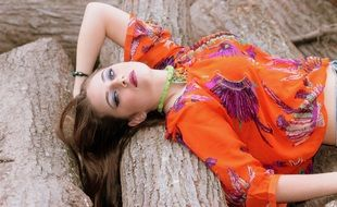 Beauty girl lying on the wood