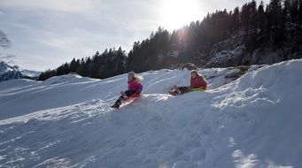 children having winter fun
