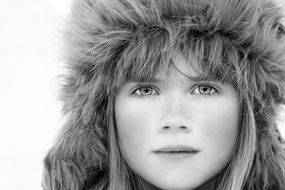 girl in a fur hat with a beautiful face