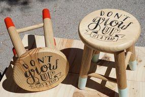 wooden chairs with inscriptions