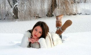 young woman posing on the snow