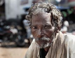 Beggar on Street, old dark skin man portrait, India