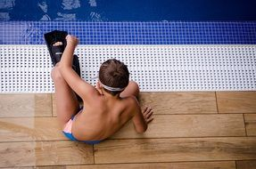 boy in the pool with fins on his feet