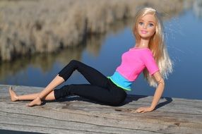 barbie doll on a wooden pier