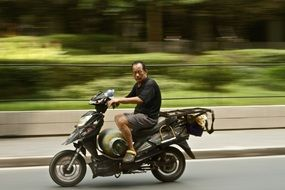 asian man riding a motorcycle