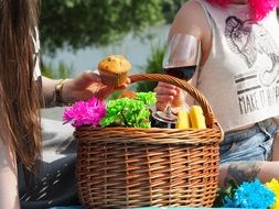 Wicker basket with food on a picnic