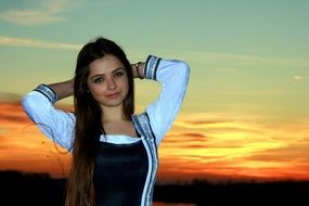 girl with long hair at sunset
