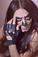 young woman with skull makeup