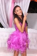 happy teen girl in fluffy purple dress posing at Birthday