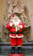 Santa Claus figure in a red suit