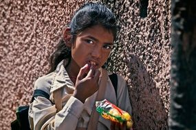 Indian student with food on a city street