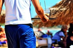 photo of a beach waiter