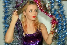 girl in colorful Christmas tinsel