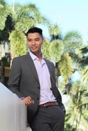 happy young asian man in business suit at palms, usa, Hawaii