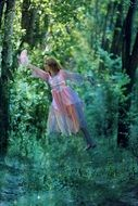 levitating young woman in the magic forest